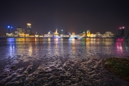 The iconic skyline of The Bund in Shanghai. A low tide night with little traffic in the river on this cold night. The texture in the mud provided great reflection of the light across the river. Hope you enjoy it!