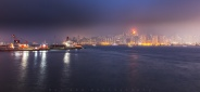 A foggy night of Hong Kong island west side. Buildings are disappearing in the distance. Adding a great mood to the city lights beauty.