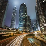 The twin towers of the IFC Buildings on a cloudy, foggy evening with these car light trails bending at this corner of the Central District in Hong Kong Island. Hope you enjoy!
