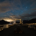 A month ago firends of mine was visiting from Shanghai and we went to Porteau Cove one night hoping to see a starry dark night sky. When we arrived, the sky was completely coverd with clouds. It was a little dissapointed at the time, but after we waited there for about an hour with freezing cold wind chill. The sky finally clearing up and this is the moment of that 50/50 situation. It was worth the wait in the cold for sure! Would you do that?