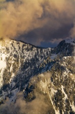 Sunset light shining on mountain top at Cypress Mountain, BC. Have a great day!