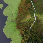 Overhead shot top down view of hiking trail along the lake