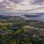 It was about half hour before the sun seting behind and the sky just started adding colour on to the clouds. Aerial shot taken up on Cypress Mountain with West Vancouver filling up most of the foreground. Overlooking Vancouver downtown, Lions Gate bridge, and Stanley Park in the middle. And Lower Mainland sticking to the entire horizon fading in the distance. Have a great day!