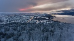A beautiful sunset up on Burnaby Mountain. It was snowing almost the entire day with the sun breaking through some clouds showing some color. Trees top are covered with snow gave a nice tones for the foreground. Hope you enjoy it!