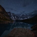 Another great night at Moraine Lake shooting for quite a while. This was taken earlier that night before clouds filling up the sky. Digital blended with 3 shots on this one. One for the background, another on the foreground, plus a focus blend on the big bold rock you are looking at. Have a wonderful night!