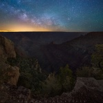 Milky way above Grand Canyon. It is a composite as there is no way to capture the massive canyon on a moonless night. So the foreground is actually taken before dawn where there are enough light to have a long exposure shot of the majestic Grand Canyon, and at the same time dark enough so that the canyon fade into darkness in distance. Hope you enjoy it and have a great night!