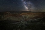 A composite shot of Painted Hills under the milky way