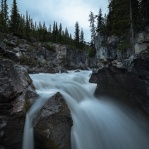 The upper section of the Panther Falls in Jasper National Park on a cloudy evening.