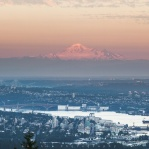 Dusk Lights on Mount Baker in Washington State, US as seen from Cypress Mountain in Vanocouver, Canada. And for anyone who know a little about Vancouver, you can see 2nd Narrows Bridge and Port Mann Bridge in the distance.