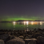 Green lights glow above est Vancouver from the recent aurora borealis display taken from Spanish Banks, Vancouver, British Columbia
