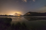 A smokey night at Vermilion Lake back in August. Layer of smoke tinted in golden color with the lights from Banff under Mount Rundle. hope you enjoy!